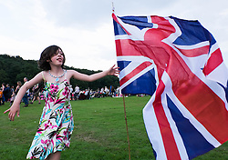 © Licensed to London News Pictures.22/08/15<br /> Castle Howard, North Yorkshire, UK. <br /> <br /> OLIVIA BROPHY, 6, from Redcar runs around a Union Flag planted in the ground as hundreds of people attend the 25th anniversary of the Castle Howard Proms event near York. The theme of the event this year is a commemoration of the 75th anniversary of the Battle of Britain and the 70th anniversary of VE day and brings an evening of classic musical favourites celebrating Britishness to the lawns of Castle Howard.<br /> <br /> Photo credit : Ian Forsyth/LNP
