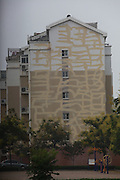 DONGYING, CHINA - SEPTEMBER 08: (CHINA OUT) <br /> <br /> Bandage Buildings<br /> <br /> Building full of white mending traces left by workers is seen on July 14, 2014 in Dongying, Shandong province of China. Two buildings full of cracks gets fixed by workers, and the white mending traces looks like bandages on the building.<br /> ©Exclusivepix