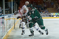 KELOWNA, CANADA - DECEMBER 30: Brycen Martin #4 of Everett Silvertips checks Gordie Ballhorn #4 of Kelowna Rockets on December 30, 2015 at Prospera Place in Kelowna, British Columbia, Canada.  (Photo by Marissa Baecker/Shoot the Breeze)  *** Local Caption *** Brycen Martin; Gordie Ballhorn;