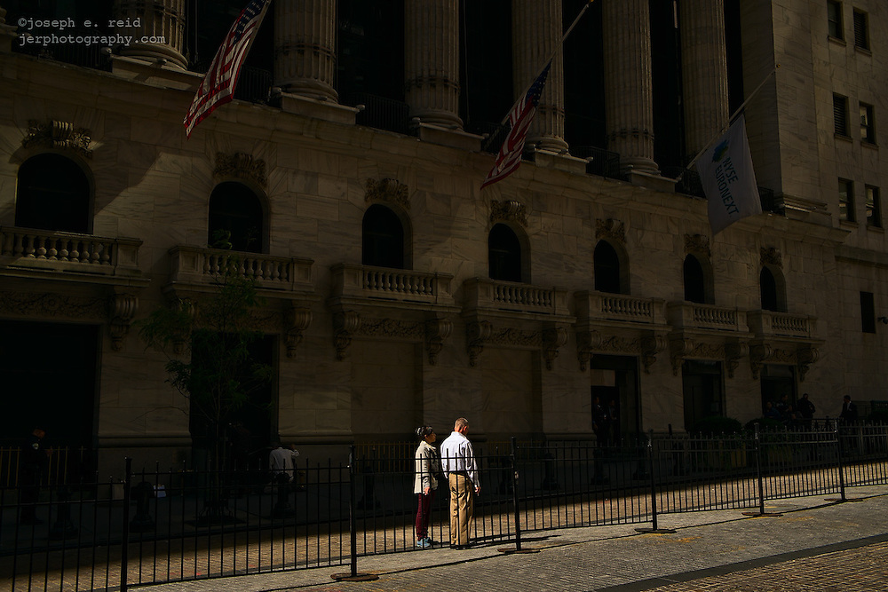 Two people outside the New York Stock Exchange