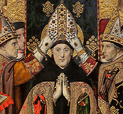 Consecration of St Augustin, or Consagracio de Sant Agusti, detail, c. 1462-75, tempera and stucco relief with gold leaf, from the St Augustine Altarpiece, by Jaume Huguet, 1412-92, in Gothic style, in the Museu Nacional d'Art de Catalunya, Barcelona, Spain. The painting depicts the saint being crowned by several bishops in contemporary dress. This is a panel from the altarpiece from the convent church of Sant Agusti Vell, Barcelona, commissioned by the Guild of Tanners and painted by Jaume Huguet and Pau Vergos. The MNAC holds 7 of the 8 surviving panels from this altarpiece. Picture by Manuel Cohen