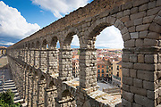 Famous spectacular Roman aqueduct, built of granite blocks, and Plaza del Azoguejo, Segovia, Spain