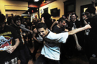 Fans dance to the rhythms of Vianna, a band from Salinas who headlined Saturday night's show at Pica Fresh Mex restaurant in Oldtown.