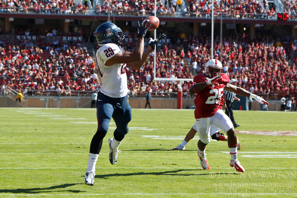 PALO ALTO, CA - OCTOBER 06: Wide receiver Austin Hill #29 of the Arizona Wildcats catches a pass for a touchdown in front of cornerback Alex Carter #25 of the Stanford Cardinal during the third quarter at Stanford Stadium on October 6, 2012 in Palo Alto, California. The Stanford Cardinal defeated the Arizona Wildcats 54-48 in overtime. (Photo by Jason O. Watson/Getty Images) *** Local Caption *** Austin Hill; Alex Carter