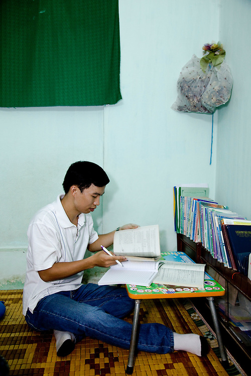 Tran Van Giap 28 in Ho Chi Minh City. With wife Le Thi Binh, at Truong Thpt school teaching Year 12 maths, at home with his text books riding his motor bike, and a portrait at home.