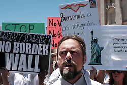June 30, 2018 - Nogales, Arizona, U.S - Families Belong Together hold protest march in Nogales, Arizona. It was one of hundreds demonstrations throughout the United States against the Trump administrations policy of separating children from their parents who are caught entering the U.S. illegally . Although the President has since reversed his original decision thousands of migrant children remain apart from their parents. Protestors marched through the border town of Nogales and ended up blocking traffic at the DeConcini port of entry for several hours. (Credit Image: © Christopher Brown via ZUMA Wire)