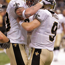 2009 October 18: New Orleans Saints tight end Jeremy Shockey (88) celebrates with quarterback Drew Brees (9) after scoring a touchdown in the first quarter against the New York Giants at the Louisiana Superdome in New Orleans, Louisiana.