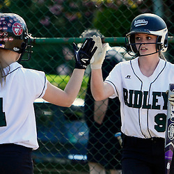 Staff photos by Tom Kelly IV<br /> Ridley's L.A. Jenkins (4) congratulates J. Laughlin (9) after she scored during the Ridley at Upper Darby softball game on Wednesday.