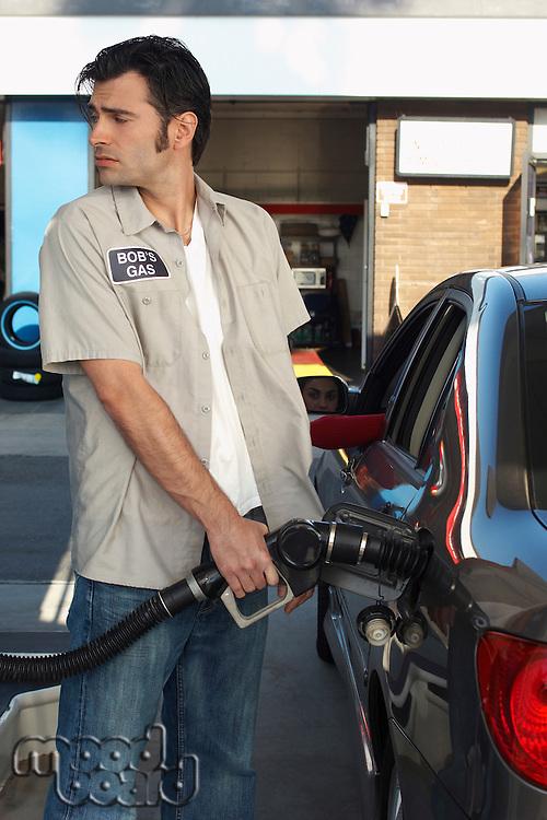 Service attendant pumping gas