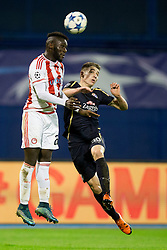 Arthur Masuaku #26 of Olympiakos and Marko Rog #30 of GNK Dinamo Zagreb during football match between GNK Dinamo Zagreb and Olympiakos in Group F of Group Stage of UEFA Champions League 2015/16, on October 20, 2015 in Stadium Maksimir, Zagreb, Croatia. Photo by Urban Urbanc / Sportida