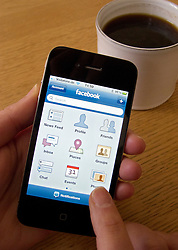 Using Facebook social networking app on an Apple iphone 4G smart phone