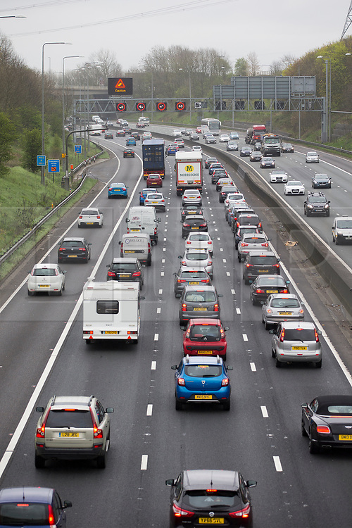 © Licensed to London News Pictures. 14/04/2017. Huddersfield UK. Picture shows heavy traffic on the M62 near Bradford in Yorkshire as people make their getaway for the easter weekend. Photo credit: Andrew McCaren/LNP