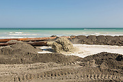 The Army Corps of Engineers use a pipeline to sluice sand from offshore to restore the beach during a major beach replenishment project May 12, 2014 in Folly Beach, SC.