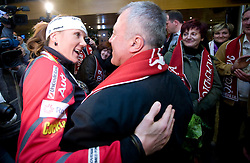Slovenian athlete Petra Majdic celebrates with her father when she arrived home with cristal globus at the end of the nordic season 2008/2009, on March 23, 2009, at airport Jozeta Pucnika, Brnik, Slovenia. (Photo by Vid Ponikvar / Sportida)
