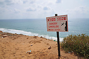Israel, Sharon region, Netanya, Danger landslide warning sign on the cliff of the promenade