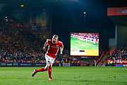 Charlton Athletic midfielder Chris Solly (20) scores the first penalty and celebrates during the EFL Sky Bet League 1 second leg Play-Off match between Charlton Athletic and Doncaster Rovers at The Valley, London, England on 17 May 2019.