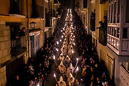 Penitents from 'Cristo de la Buena Muerte' or 'Good Dead Christ' brotherhood take part in a procession in Zamora, Spain, on the early hours of Tuesday, March 31, 2015. Hundreds of processions take place throughout Spain during the Easter Holy Week.