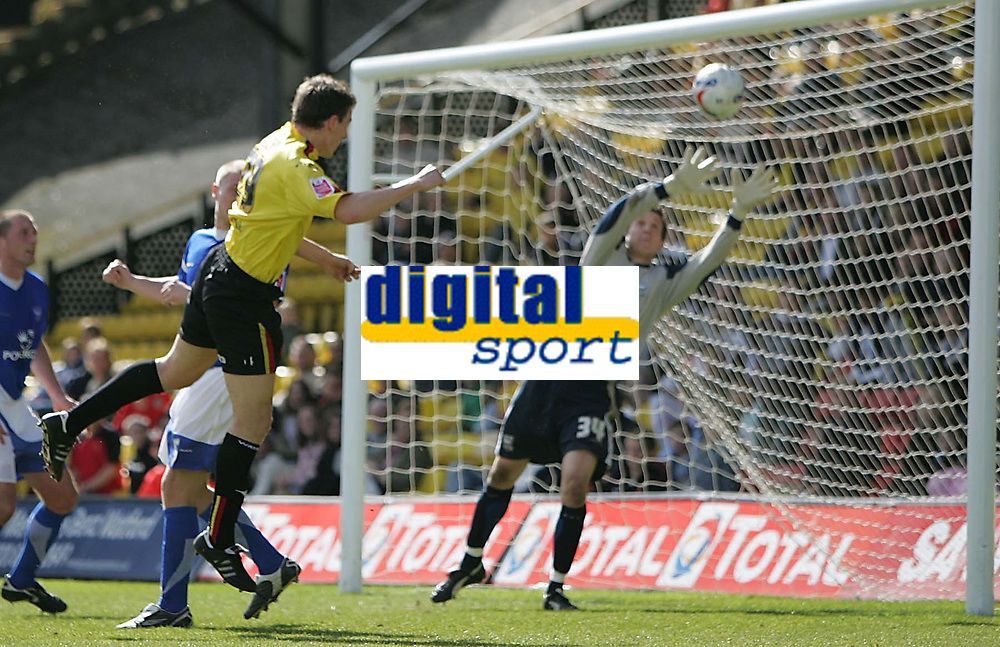 Photo: Lee Earle.<br /> Watford v Ipswich Town. Coca Cola Championship. 17/04/2006. Watfords' Darius Henderson (L) heads past Ipswich keeper Lewis Price to score the opening goal.