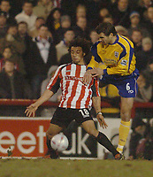 Photo. Leigh Quinnell, Digitalsport<br />   Brentford v Southampton FA cup. 01/03/2005. Southamptons Andreas Jakonsson challenges Brentfords Deon Burton