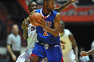 """SMU's Shawn Williams (2) vs. Ole Miss' Terrance Henry (1) at the C.M. """"Tad"""" Smith Coliseum in Oxford, Miss. on Tuesday, January 3, 2012. Ole Miss won 50-48."""
