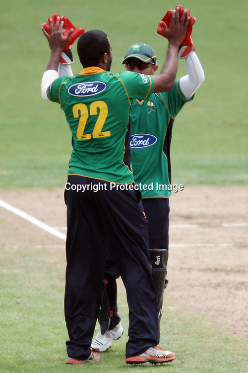 Tarun Nethula and Kruger Van Wyk celebrate Jeet Ravals wicket. Auckland Aces v Central Stags, One Day Cricket. Colin Maiden Park, Auckland, Wednesday 19 January 2011. Photo: Ella Brockelsby/photosport.co.nz