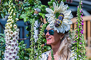 Laura Konig, sporting a bee hat that she created, on the Alitex stand - Press preview day at The RHS Chelsea Flower Show.