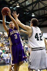30 December 2006: Zak Silas fades back away from Tyler Smith for a shot. The Titans outscored the Britons by a score of 94-80. The Britons of Albion College visited the Illinois Wesleyan Titans at the Shirk Center in Bloomington Illinois.<br />