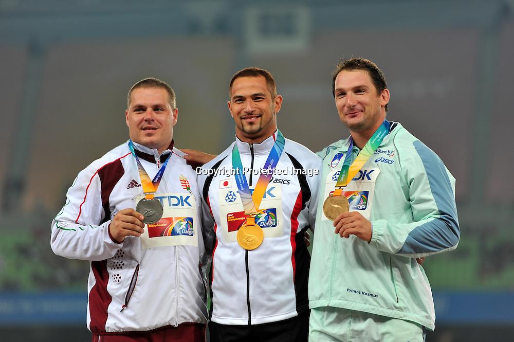 (L to R) Krisztian Pars (HUN), Koji Murofushi (JPN), Primoz Kozmus (SLO),AUGUST 29, 2011 - Athletics :The 13th IAAF World Championships in Athletics - Daegu 2011, Men's Hammer Throw Final at the Daegu Stadium, Daegu, South Korea. (Photo by Jun Tsukida/AFLO SPORT) [0003]
