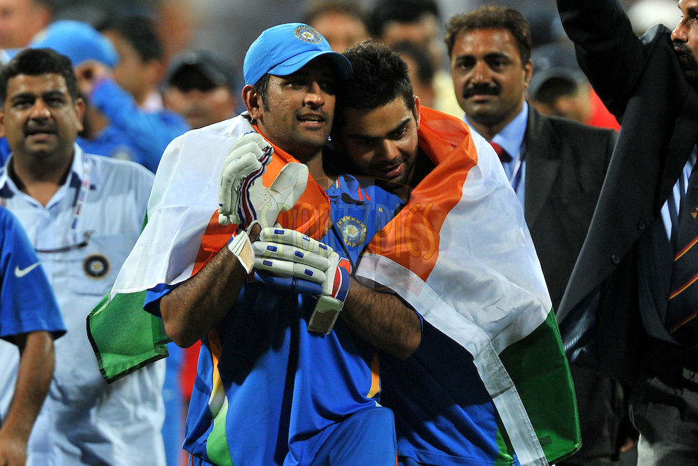 Mahendra Singh Dhoni captain of India and Virat Kohli of India celebrate after winning the  ICC Cricket World Cup Final between India and Sri Lanka held at the Wankhede Stadium in Mumbai on the 2nd April 2011..Photo by Pal Pillai/BCCI/SPORTZPICS