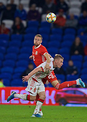 CARDIFF, WALES - Monday, September 9, 2019: Belarus' Nikolai Zolotov and Wales' substitute Chris Gunter during the International Friendly match between Wales and Belarus at the Cardiff City Stadium. (Pic by David Rawcliffe/Propaganda)