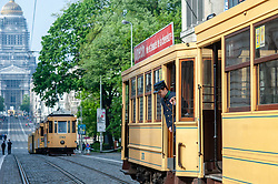 May 1, 2019 - Brussels, North Brabant, Belgium - A tram driver is seen getting out of a historical tram during the festivities..A series of festivities are held throughout the week to celebrate 150 years of the tram. On Wednesday, a large parade brought together more than 40 trams of all eras, tracing their history from the horse-drawn trams of the first years to the trams 3,000 and 4,000 that circulate today in the streets of Brussels. (Credit Image: © Ana Fernandez/SOPA Images via ZUMA Wire)