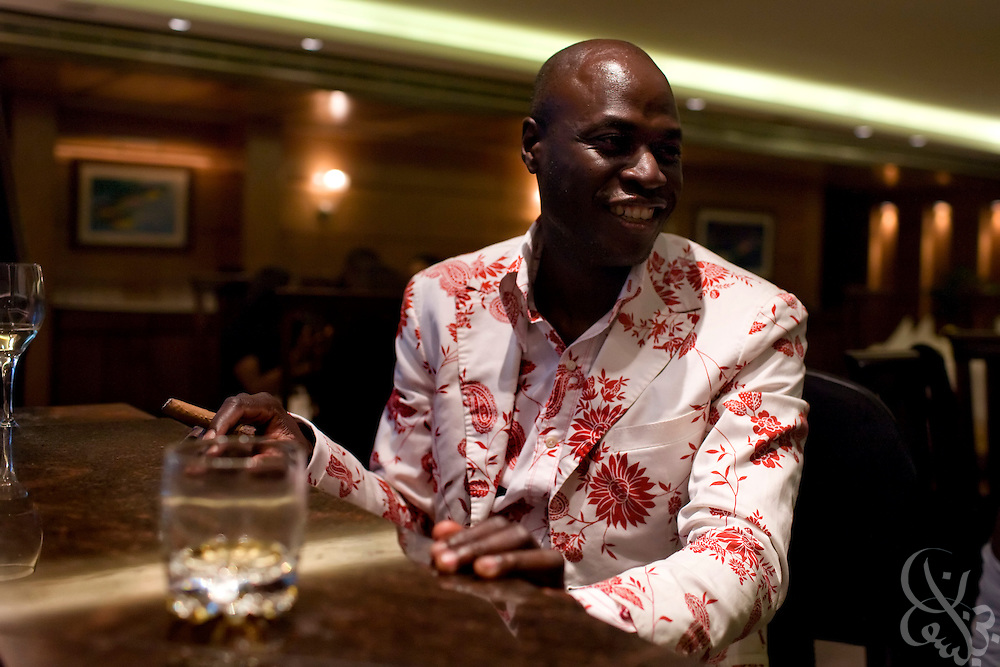 Fashion designer Ron Delice smokes cigars and drinks following the successful conclusion of the July 13, 2008 leg of the ThisDay Africa Rising music and fashion festival in Lagos, Nigeria. The three year old festival aims to raise awareness of African issues while promoting positive images of Africa using music, fashion and culture in a series of concerts and events in Nigeria, the United States and the United Kingdom.