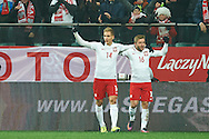 Wroclaw, Poland - 2016 November 14: (L) Lukasz Teodorczyk of Poland celebrates after scoring with his teammate Jakub Blaszczykowski of Poland during Poland v Slovenia - International Friendly Soccer Match at Municipal Stadium on November 14, 2016 in Wroclaw, Poland.<br /> <br /> Adam Nurkiewicz declares that he has no rights to the image of people at the photographs of his authorship.<br /> <br /> Picture also available in RAW (NEF) or TIFF format on special request.<br /> <br /> Any editorial, commercial or promotional use requires written permission from the author of image.<br /> <br /> Mandatory credit:<br /> Photo by © Adam Nurkiewicz / Mediasport