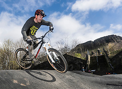 "A new bike park for mountain bikers has opened in the centre of Edinburgh. The Skelf Bike park has a 900m2 ""Pump Track"" of banked corners and mounds. The park opens today and had professional riders trying out the new track.<br /> <br /> Pictured: Professional mountain biker, Duncan Ferris who has helped to build the track"