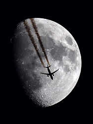 © Licensed to London News Pictures. PARIS. This stunning picture of a plane in front of the Moon was taken near Paris on 9th May 2014 by amateur hunter of unusual photos, Sebastien Lebrigand. He took the picture through a telescope with a refractor lens of 100 mm diameter with a CANON eos 60d digital camera attached. . Photo credit : Sebastien Lebrigand/LNP