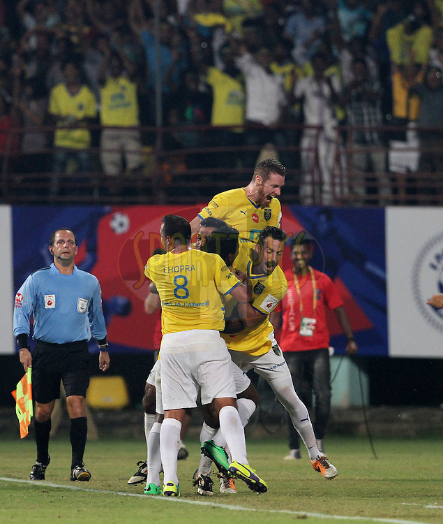Kerala Blasters FC players celebrates a goal scored by Ishfaq Ahmed of Kerala Blasters FC during the 1st Semi Final match of the Hero Indian Super League between Kerala Blasters FC and Chennaiyin FC held at the Jawaharlal Nehru Stadium, Kochi, India on the 13th December 2014.<br /> <br /> Photo by:  Vipin Pawar/ ISL/ SPORTZPICS