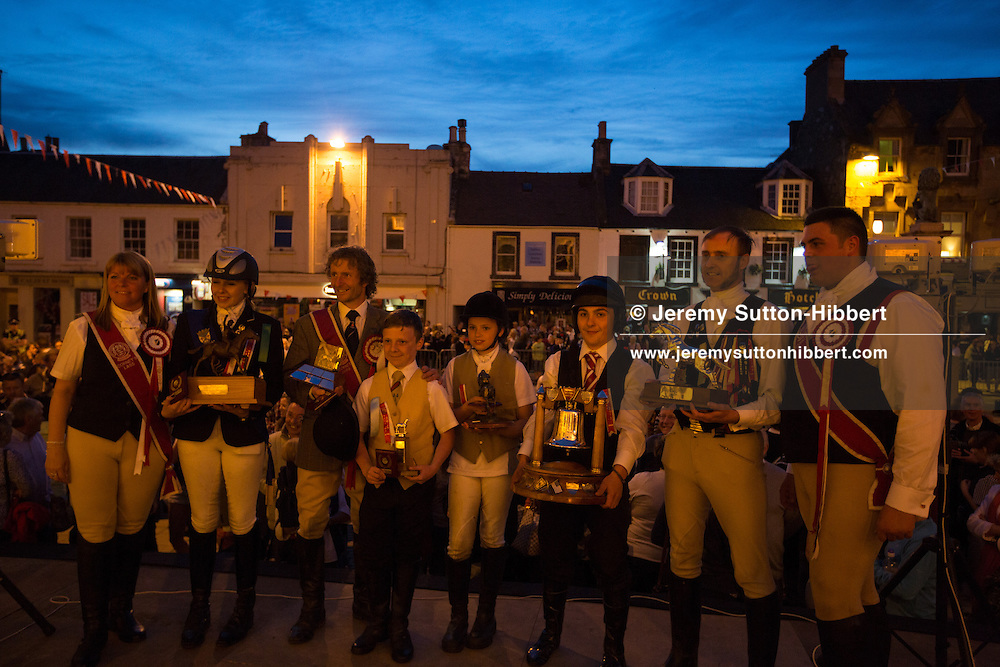 Prize giving ceremony for winners of the horse racing, at The Peebles Beltane Festival, including their Common Riding of the Marches, with Cornet Daniel Williamson, and Cornets Elect Lass Susan Thomson, in Peebles, Scotland, Wednesday 19th June 2013. <br /> N55&deg;39.087'<br /> W3&deg;11.450'