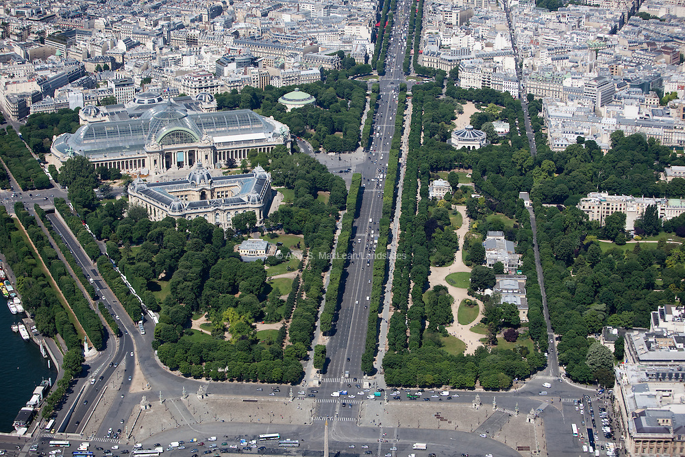 Looking down the Champs-Elysees with the Nef du Grand Palais and The Petit Palais (an art museum in the 8th arrondissement of Paris, France. It was built for the 1900 Exposition Universelle, it now houses the City of Paris Museum of Fine Arts) on the left.