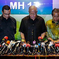 Malaysian Prime Minister Najib Razak (C) accompanied by Malaysian Defence Minister Hishamuddin Hussein (L) and Malaysian Foreign Minister Anifah Aman (R) pause during a press conference at a hotel near Kuala Lumpur International Airport (KLIA) in Sepang outside Kuala Lumpur, Malaysia, 18 May 2014. Malaysia Airlines lost contact with Flight MH17 at 5:15 pm (1415 GMT), about 50 kilometres from the Russia-Ukraine border, the airline said in a statement. The Boeing 777 departed Amsterdam at 12:15 pm and was scheduled to arrive in Kuala Lumpur at 6:10 am 18 July. The plane was carrying 280 passengers and 15 crew members, the statement said.