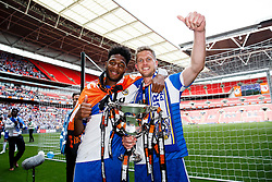 Ellis Harrison and Lee Mansell celebrate with the trophy after Bristol Rovers win the match on penalties  to secure promotion to the Football League 2 - Photo mandatory by-line: Rogan Thomson/JMP - 07966 386802 - 17/05/2015 - SPORT - FOOTBALL - London, England - Wembley Stadium - Bristol Rovers v Frimsby Town - Vanarama Conference Premier Play-off Final.
