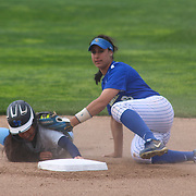 Saint Peter's College Infielder Amber Velasquez (14) slides into second base as Delaware utility player Sarah Bencivenga (9) attempts a tag in the first inning of a NCAA Non Conference Regular season game between The University Of Delaware and The Peacocks of Saint Peter's Wednesday, April 23, 2014, at UD Softball Stadium in Newark Delaware.