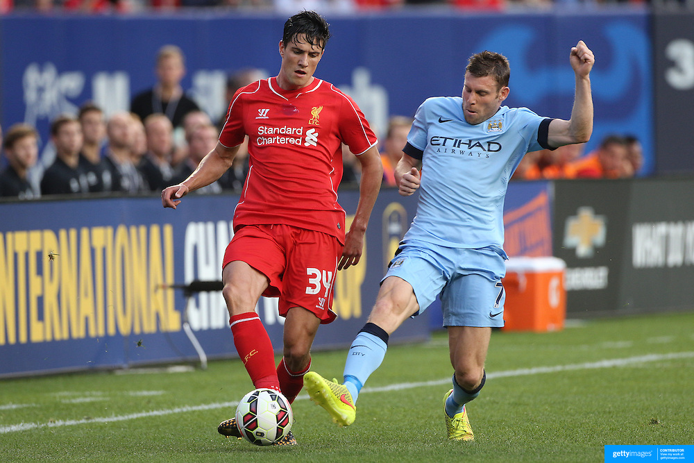 Martin Kelly, (left), Liverpool, is challenged by James Milner, Manchester City, during the Manchester City Vs Liverpool FC Guinness International Champions Cup match at Yankee Stadium, The Bronx, New York, USA. 30th July 2014. Photo Tim Clayton