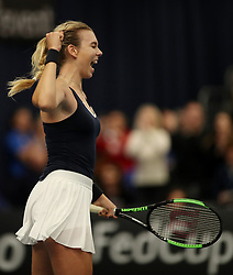 Great Britain's Katie Boulter celebrates her victory over Valentini Gramma Tikopoulou during day two of the Fed Cup at Bath University.