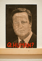 © London News Pictures. 17/11/2011. London, UK. Postcard art of David cameron with stock exchange characters over his face. Photo call for The Royal College Of Art Secret Postcards exhibition 2011. 1,119 artists and designers including the likes of Tracey Emin, Yoko Ono and Sir Paul Smith donate 2,900 postcard sized pieces of art to the RCA, which are sold anonymously for £45. : Ben Cawthra/LNP