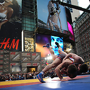 Brent Metcalf, (top), USA, in action against  Magomed Kurbanaliev, Russia, during the 'Beat The Streets' USA Vs The World, International Exhibition Wrestling in Times Square. New York, USA. 7th May 2014. Photo Tim Clayton