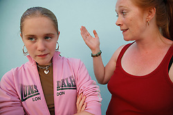 Carer or mother with sullen girl.