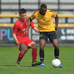 TELFORD COPYRIGHT MIKE SHERIDAN Raul Correira of Southport holds off Ross White of Telford during the National League North fixture between Southport and AFC Telford United at Haig Avenue on Saturday, August 24, 2019<br /> <br /> Picture credit: Mike Sheridan<br /> <br /> MS201920-005