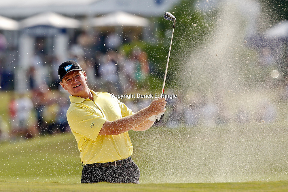 Apr 29, 2012; Avondale, LA, USA; Ernie Els hits from the sand on the second playoff at the 18th hole during the final round of the Zurich Classic of New Orleans at TPC Louisiana. Mandatory Credit: Derick E. Hingle-US PRESSWIRE