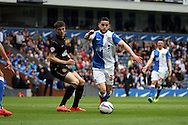 Blackburn Rovers&rsquo; Craig Conway goes past Wigan Athletic&rsquo;s Rob Kiernan. Skybet football league championship match, Blackburn Rovers v Wigan Athletic at Ewood Park in Blackburn, England on Saturday 3rd May 2014.<br /> pic by Chris Stading, Andrew Orchard sports photography.