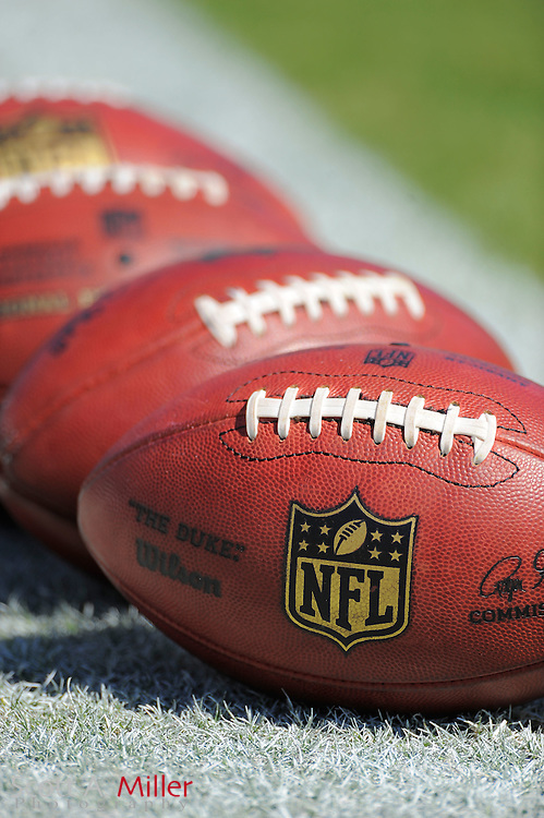 NFL footballs sit on the field prior to the Jacksonville Jaguars game against the New Orleans Saints at EverBank Field on Oct. 2, 2011 in Jacksonville, Fla...©2011 Scott A. Miller